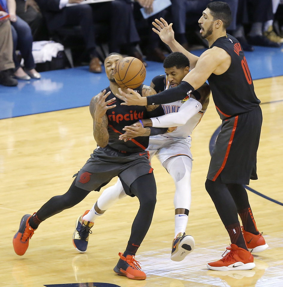 Photo - Oklahoma City's Paul George (13) is called for a foul as he gets caught between Portland's Damian Lillard (0) and Enes Kanter (00) during Game 4 in the first round of the NBA playoffs between the Portland Trail Blazers and the Oklahoma City Thunder at Chesapeake Energy Arena in Oklahoma City, Sunday, April 21, 2019. Photo by Bryan Terry, The Oklahoman