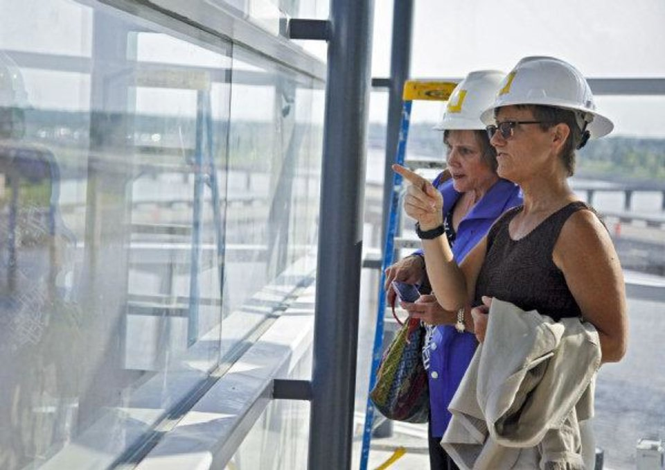 Photo - Nola Harrison and Lissa Wohltmann, from left, check out the sights and view from the Chesapeake Finish Line Tower as construction continues on the Oklahoma River on, Tuesday, May 31, 2011. Photo by Chris Landsberger, The Oklahoman ORG XMIT: KOD