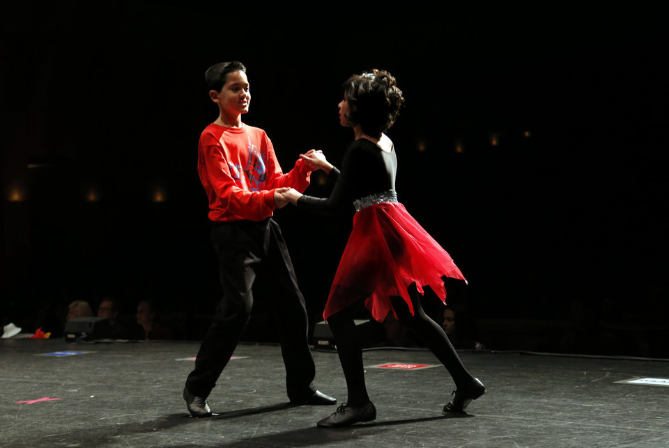 Photo -  Mark Twain's Jody Botello and Nagela Ulloa perform the swing during the LifeChange Ballroom competition at the Rose State Performing Arts Theatre in Midwest City. Photo by Sarah Phipps, The Oklahoman   Sarah PHIpps -  Sarah Phipps
