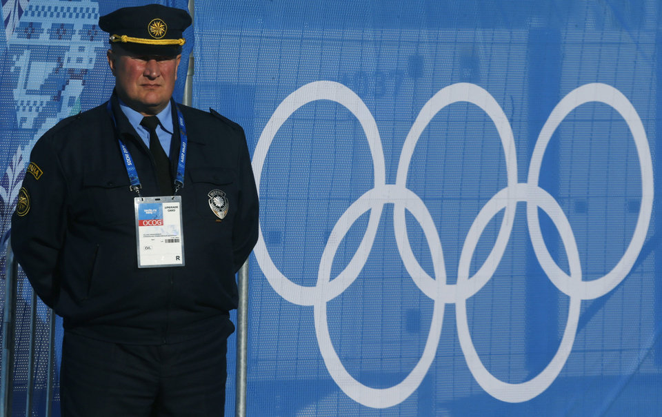 Photo - A security guard stands at Olympic Park in Sochi, Russia, Sunday, Feb. 2, 2014. Sochi will host the 2014 Winter Olympic Games from Feb. 7 to Feb. 23. (AP Photo/Alexander Demianchuk, Pool)