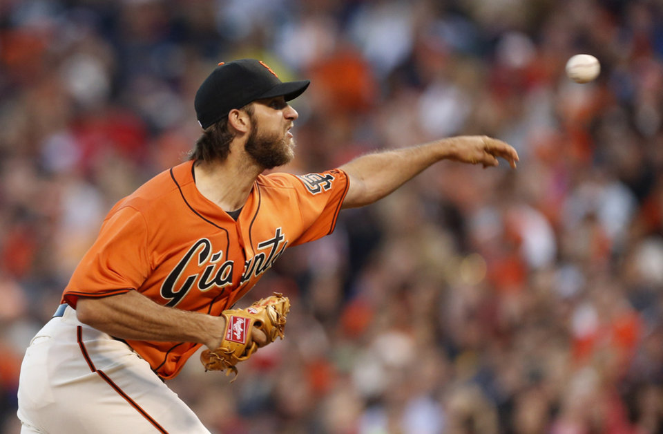 Photo - San Francisco Giants pitcher Madison Bumgarner releases the ball during the third inning of a baseball game against the Philadelphia Phillies, Friday, Aug. 15, 2014, in San Francisco. (AP Photo/Beck Diefenbach)