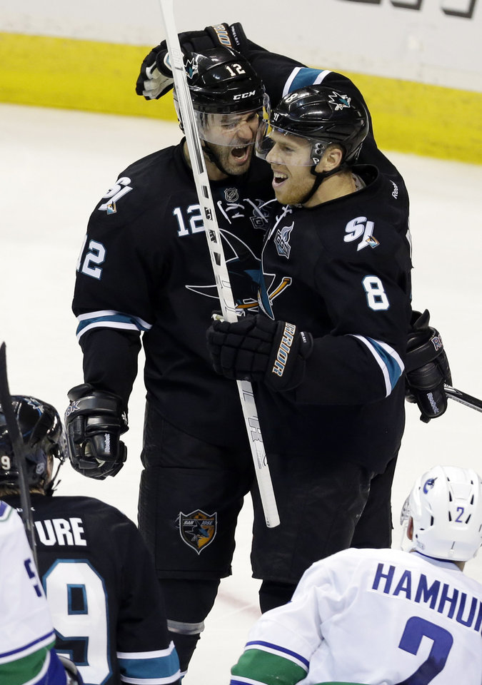 San Jose Sharks center Joe Pavelski (8) celebrates his goal with teammate Patrick Marleau (12) during the third period of Game 4 of their first-round NHL hockey Stanley Cup playoff series in San Jose, Calif., Tuesday, May 7, 2013.  San Jose won 4-3 in overtime. (AP Photo/Marcio Jose Sanchez)