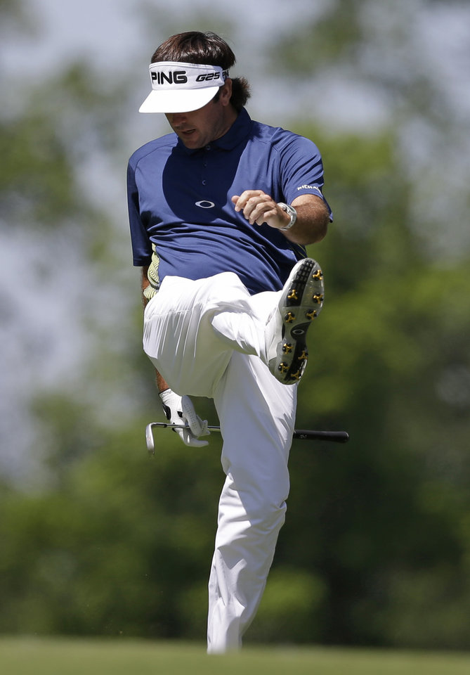 Photo - Bubba Watson kicks a divot after hitting to the ninth green during the second round of the Memorial golf tournament Friday, May 30, 2014, in Dublin, Ohio. (AP Photo/Darron Cummings)