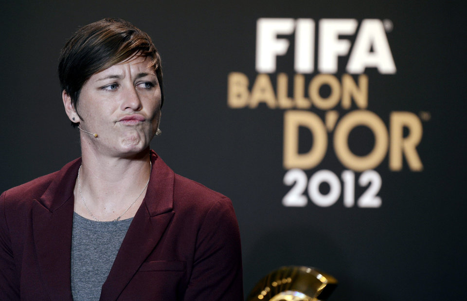 Photo - FILE - In this Jan. 7, 2013, file photo, USA's Abby Wambach speaks at a press conference during the FIFA Ballon d'Or Gala 2013 held at the Kongresshaus in Zurich, Switzerland. The law firm that represents soccer players who object to an artificial turf surface at the Women's World Cup says a FIFA-commissioned survey of players shows that 77 percent feel major tournaments should be played on natural grass. But that wasn't enough to sway organizers to let the women play on grass. Wambach, a group of teammates and a number of international players are protesting the artificial surface, claiming that forcing the women to play on turf amounts to gender discrimination. (AP Photo/Keystone/Walter Bieri, File)