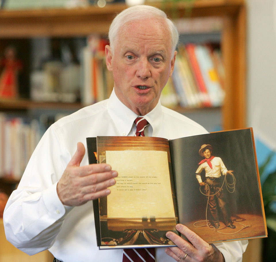 Photo - Gov. Frank Keating speaks to students at Wilson Elementary School about  his book about Will Rogers in Oklahoma City , Okla. November 12, 2008.  By Steve Gooch