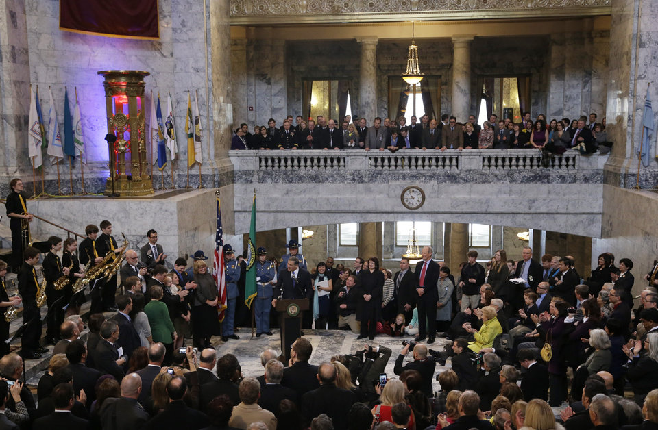 Photo - Gov. Jay Inslee, speaks at the podium after he was sworn in as Washington state Governor, Wednesday, Jan. 16, 2013, in the rotunda of the Legislative Building at the Capitol in Olympia, Wash. (AP Photo/Ted S. Warren)