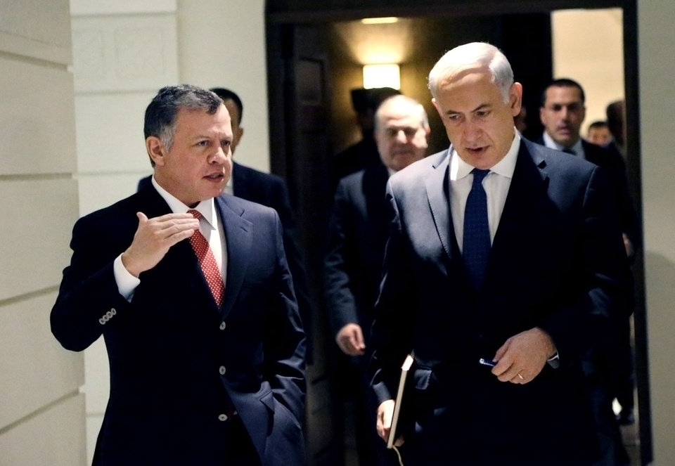 Photo - In this photo released by the Jordanian Royal Palace, Israeli Prime Minister Benjamin Netanyahu, right, listens to Jordan's King Abdullah II, left, as thy meet at the Royal Palace in Amman, Jordan, Thursday, Jan. 16, 2014. (AP Photo/Yousef Allan, Jordanian Royal Palace)