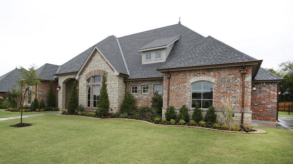 Johnston Builders built this home for the Pasrade of Homes at 12508 Deep Wood Creek Drive in the Hidden Creek addition, north of NW 122 and east of MacArthur Boulevard. <strong>Steve Gooch - The Oklahoman</strong>