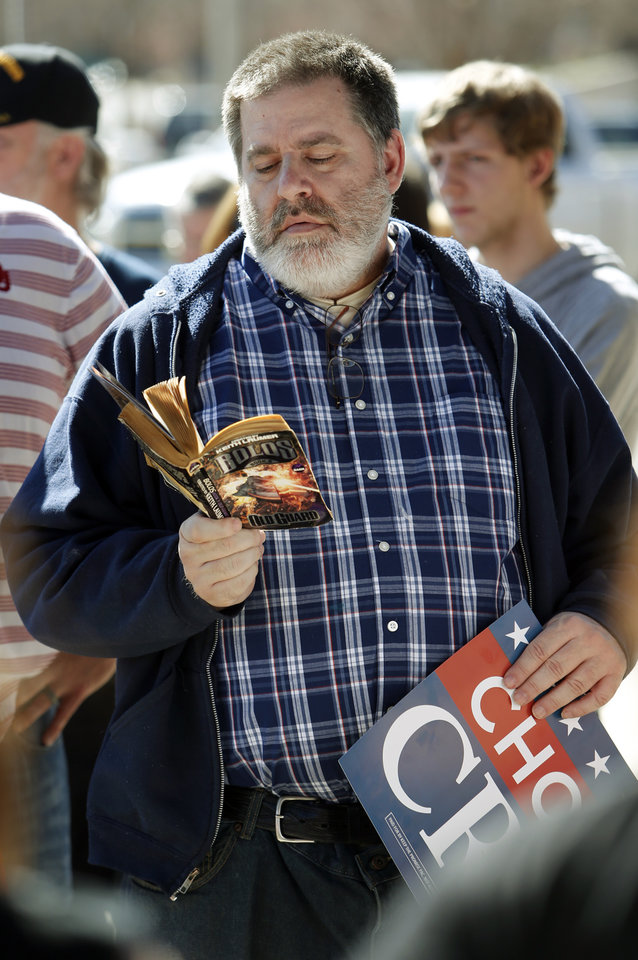Photo - Weatherford, Okla. resident Don Reynolds passes time outside waiting to enter the Chevy Bricktown Event Center as Republican presidential candidate Ted Cruz is scheduled to speak as part of the Oklahoma City Courageous Conservatives Rally on Sunday, Feb. 28, 2016 in Oklahoma City, Okla.  Photo by Steve Sisney, The Oklahoman