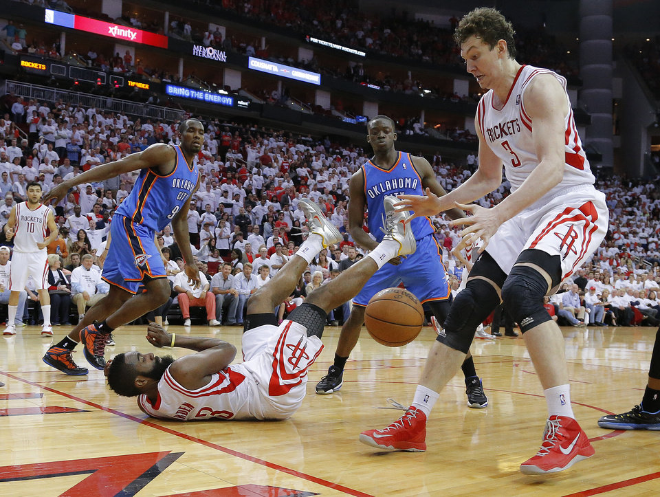 Photo - Houston's Omer Asik (3) goes for the ball as James Harden (13) hits the ground beside Oklahoma City's Serge Ibaka (9) and Reggie Jackson (15) during Game 3 in the first round of the NBA playoffs between the Oklahoma City Thunder and the Houston Rockets at the Toyota Center in Houston, Texas, Sat., April 27, 2013. Oklahoma City won 104-101. Photo by Bryan Terry, The Oklahoman