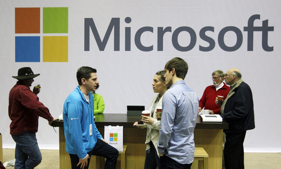 FILE - In this Nov. 28, 2012, file photo, Microsoft Corp. retail store employees and guests mingle at a pop-up Microsoft Store during Microsoft's annual meeting of shareholders, in Bellevue, Wash. Longtime users of Hotmail, MSN and other Microsoft email services will start noticing a big change: When they sign in to check messages, they'll be sent to a new service called Outlook.com. (AP Photo/Ted S. Warren,File)