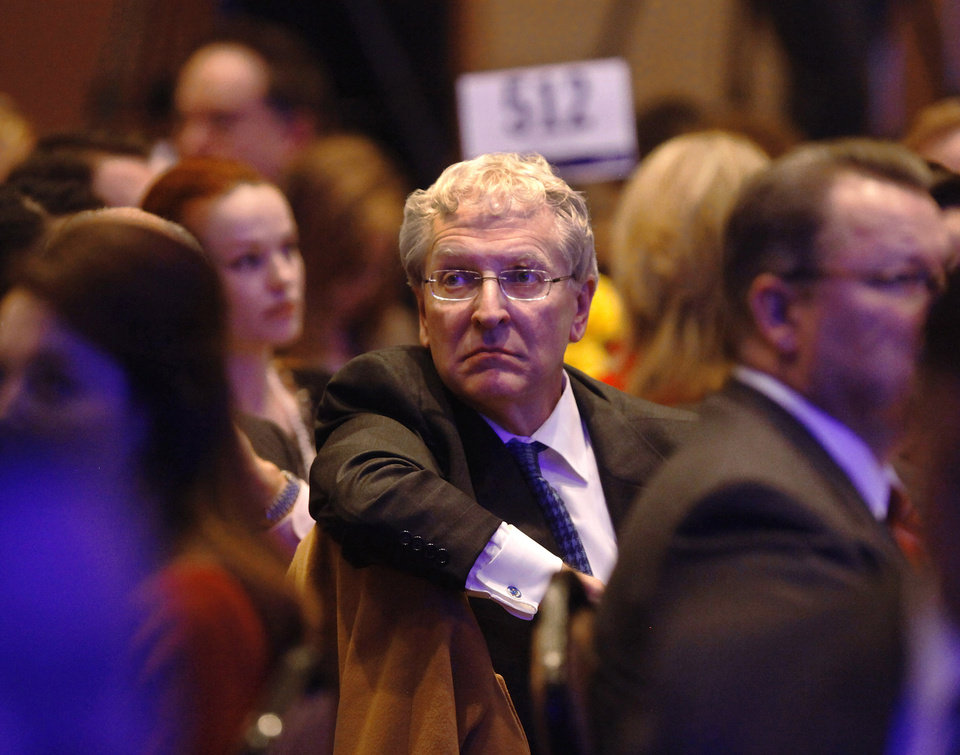 Robert Henry, president of Oklahoma City University, sits among the crowd listening to Mayor Cornett's speech. Oklahoma City Mayor Mick Cornett touts recent successes and future goals of the city he leads  during his 2013 State of the City address Thursday, Jan. 24, 2013.  Officials with the Greater Oklahoma City Chamber, host of the luncheon, said a record audience of 1500 attended the annual event, held in the Cox Convention Center in downtown Oklahoma City  Photo by Jim Beckel, The Oklahoman