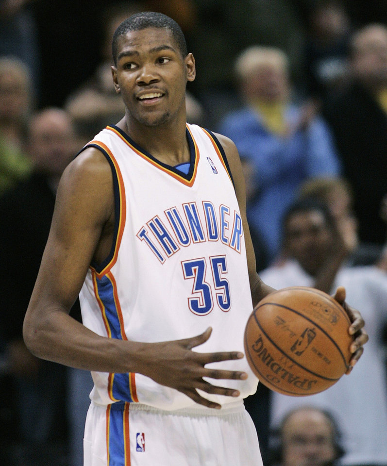 Photo - Oklahoma City Thunder guard Kevin Durant smiles as he holds the ball as the NBA basketball game against the New York Knicks draws to a close in Oklahoma City, Tuesday, Jan. 6, 2009. Durant had 27 points as Oklahoma City won 107-99. (AP Photo/Sue Ogrocki) ORG XMIT: OKSO106