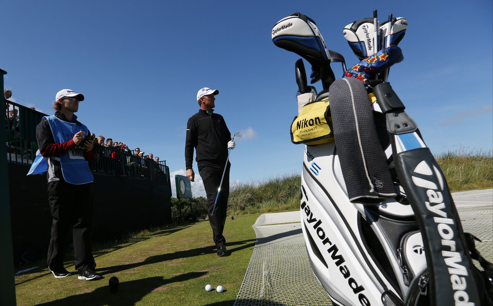 Photo - Robert Karlsson of Sweden prepares to play off the 13th tee during a practice round ahead of the British Open Golf championship at the Royal Liverpool golf club, Hoylake, England, Tuesday July 15, 2014. The British Open starts on Thursday July 17. (AP Photo/Jon Super)