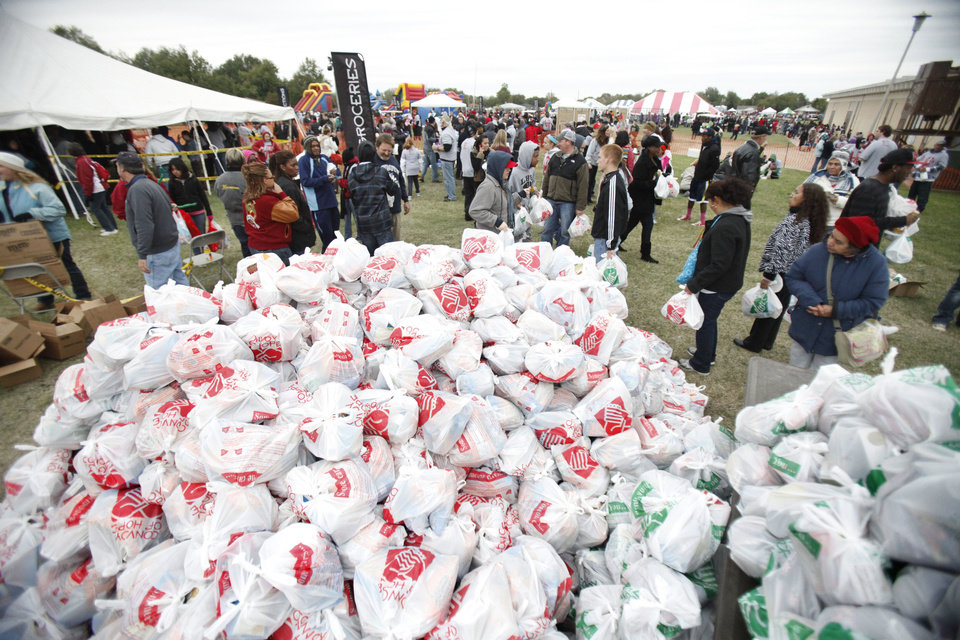 Photo - In last year's ONE DAY outreach event, piles of groceries were distributed to metro residents. This year's event is set for Aug. 24. Archive photo by Paul Hellstern, The Oklahoman.  PAUL HELLSTERN