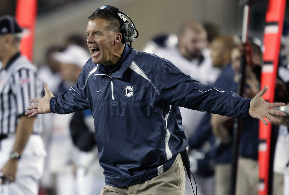 Connecticut head coach Randy Edsall shouts at an official after his team was penalized during the first quarter of an NCAA college football game against South Florida, Saturday, Dec. 4, 2010, in Tampa, Fla. (AP Photo/Chris O\'Meara)
