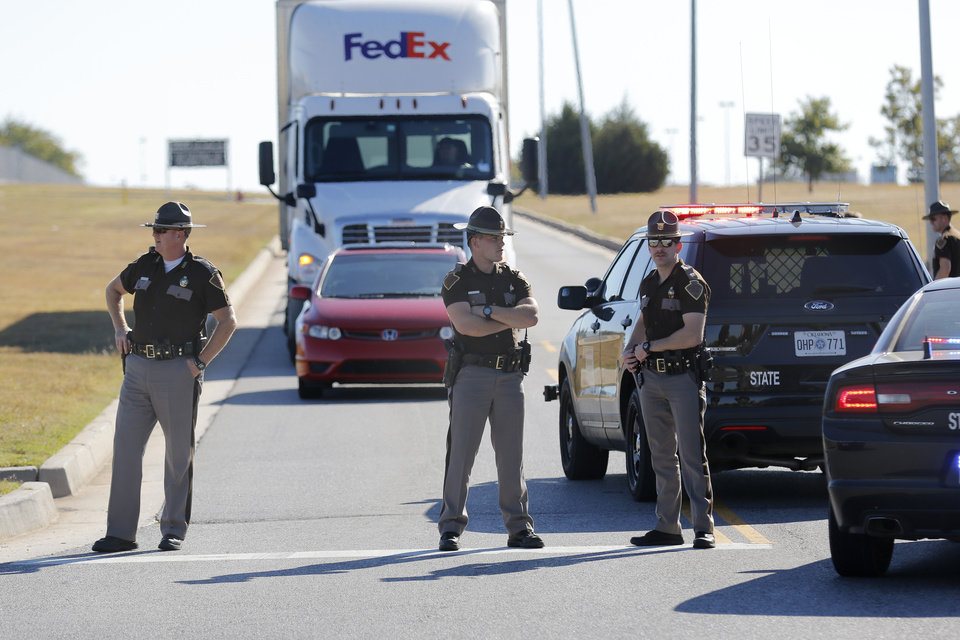 Photo - Oklahoma Highway Patrol Troopers block traffic at a checkpoint at Will Rogers World Airport, in Oklahoma City, Tuesday November, 15 2016. The airport was put on lockdown after a shooting in the main terminal. Photo By Steve Gooch, The Oklahoman