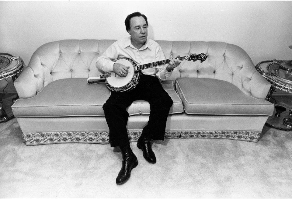Photo -   FILE - In this photo taken Aug. 9, 1982 file photo, bluegrass legend and banjo pioneer Earl Scruggs plays his banjo. Scruggs' son Gary said his father passed away Wednesday morning, March 28, 2012 at a Nashville, Tenn., hospital of natural causes. He was 88. (AP Photo/Mark Humphrey, File)