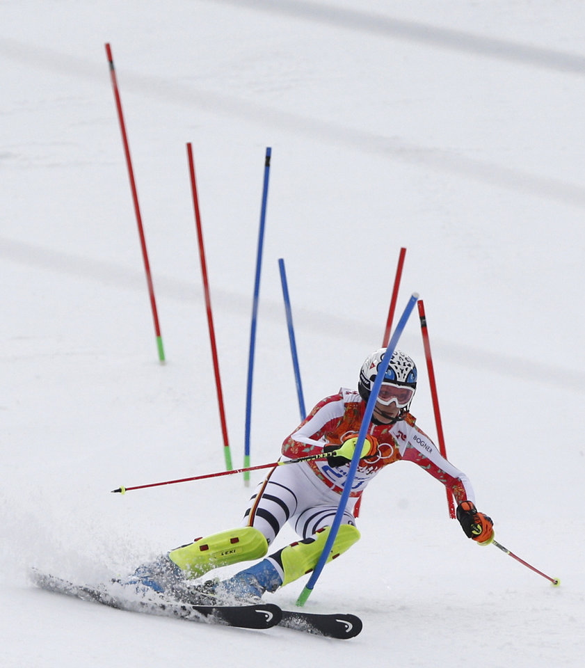 Photo - Germany's Maria Hoefl-Riesch skis past the gates during the slalom portion of the women's supercombined at the Sochi 2014 Winter Olympics, Monday, Feb. 10, 2014, in Krasnaya Polyana, Russia. (AP Photo/Christophe Ena)