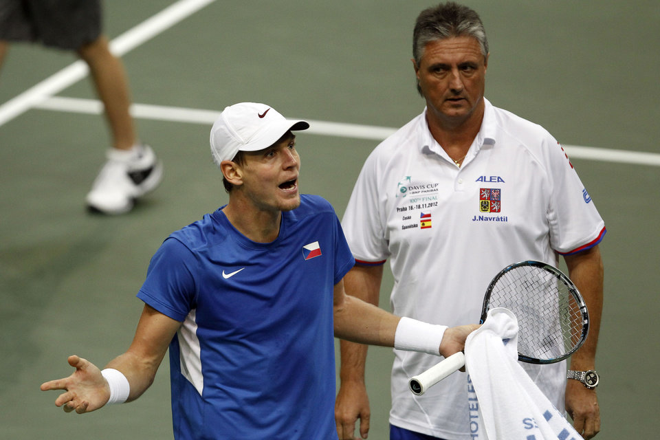 Photo -   Czech Republic's Tomas Berdych, left, reacts as the Czech team captain Jaroslav Navratil looks on during his Davis Cup finals tennis match against Spain's David Ferrer in Prague, Czech Republic, Sunday, Nov. 18, 2012.(AP Photo/ Marko Drobnjakovic)