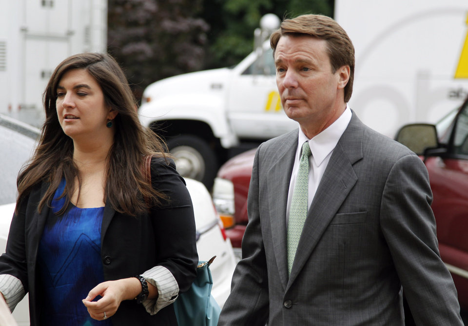 Photo -   Cate Edwards walks with her father John Edwards into the federal courthouse in Greensboro, N.C., as the defense continues in John Edwards' campaign corruption trial Monday, May 14, 2012. (AP Photo/Bob Leverone)