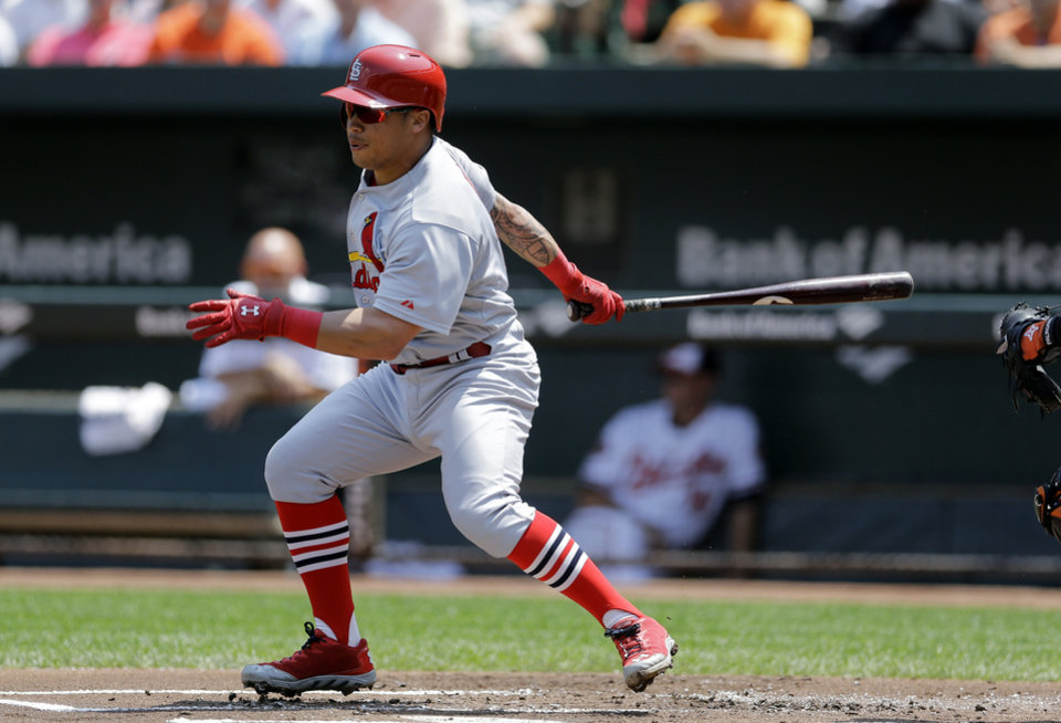 Photo - St. Louis Cardinals' Kolten Wong singles in the first inning of an interleague baseball game against the Baltimore Orioles, Sunday, Aug. 10, 2014, in Baltimore. (AP Photo/Patrick Semansky)