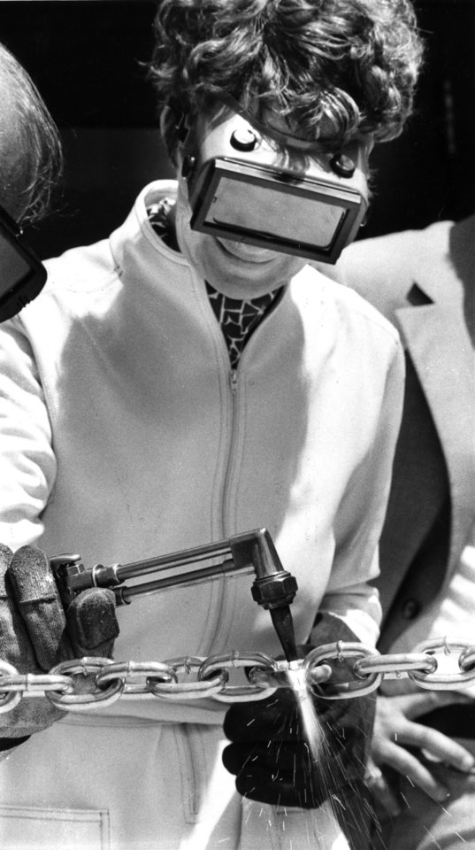 """Chain Cutter--- Mayor Patience Latting cuts a chain 'ribbon' with an acetylene torch during dedication ceremonies Wednesday for the new Career Learning Center at South Oklahoma City Junior College.  The new building will house programs related to heavy manufacturing and production."" Staff photo by Michal Thompson taken 8/23/78; photo ran in the 8/24/78 Daily Oklahoman."