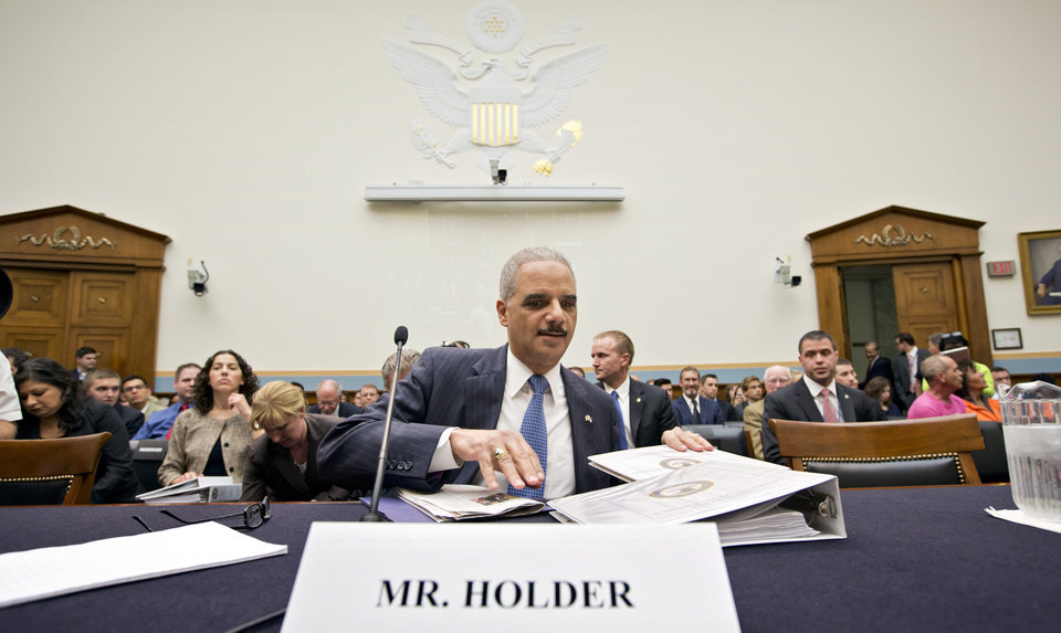 Photo - Attorney General Eric Holder, the nation's top law enforcement official, prepares to testify on Capitol Hill in Washington, Wednesday, May 15, 2013, before the House Judiciary Committee oversight hearing on the Justice Department. House Judiciary Committee Chairman Rep. Bob Goodlatte,R-Va., wants to know more about the unwarranted targeting of Tea Party and other conservative groups by the Internal Revenue Service and the Justice Department's secret seizure of telephone records at The Associated Press.  (AP Photo/J. Scott Applewhite)