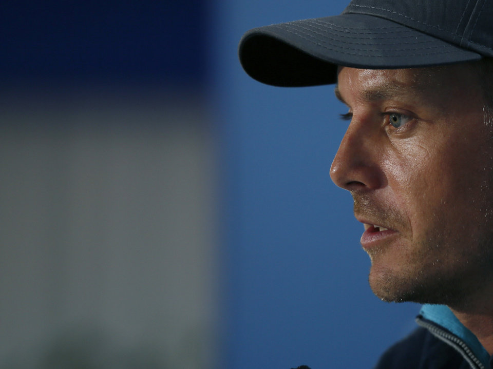 Photo - Henrik Stenson of Sweden talks during a press conference ahead of the British Open Golf championship at the Royal Liverpool golf club, Hoylake, England, Wednesday July 16, 2014. The British Open Golf championship starts Thursday July 17. (AP Photo/Alastair Grant)