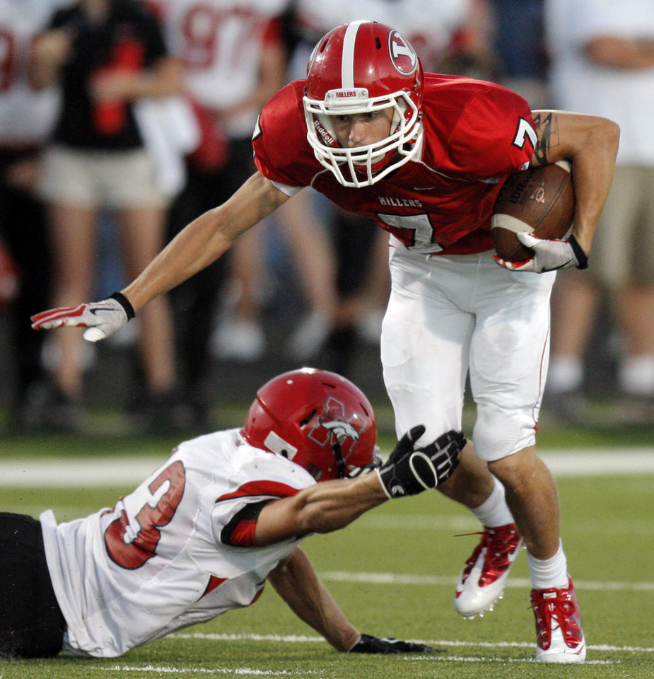 Photo - Yukon's Kaiden Horn breaks away from Cale Witter of Mustang after a catch during the high school football game between Mustang and Yukon at Yukon High School in Yukon, Okla., Friday, Sept. 3, 2010. Photo by Nate Billings, The Oklahoman