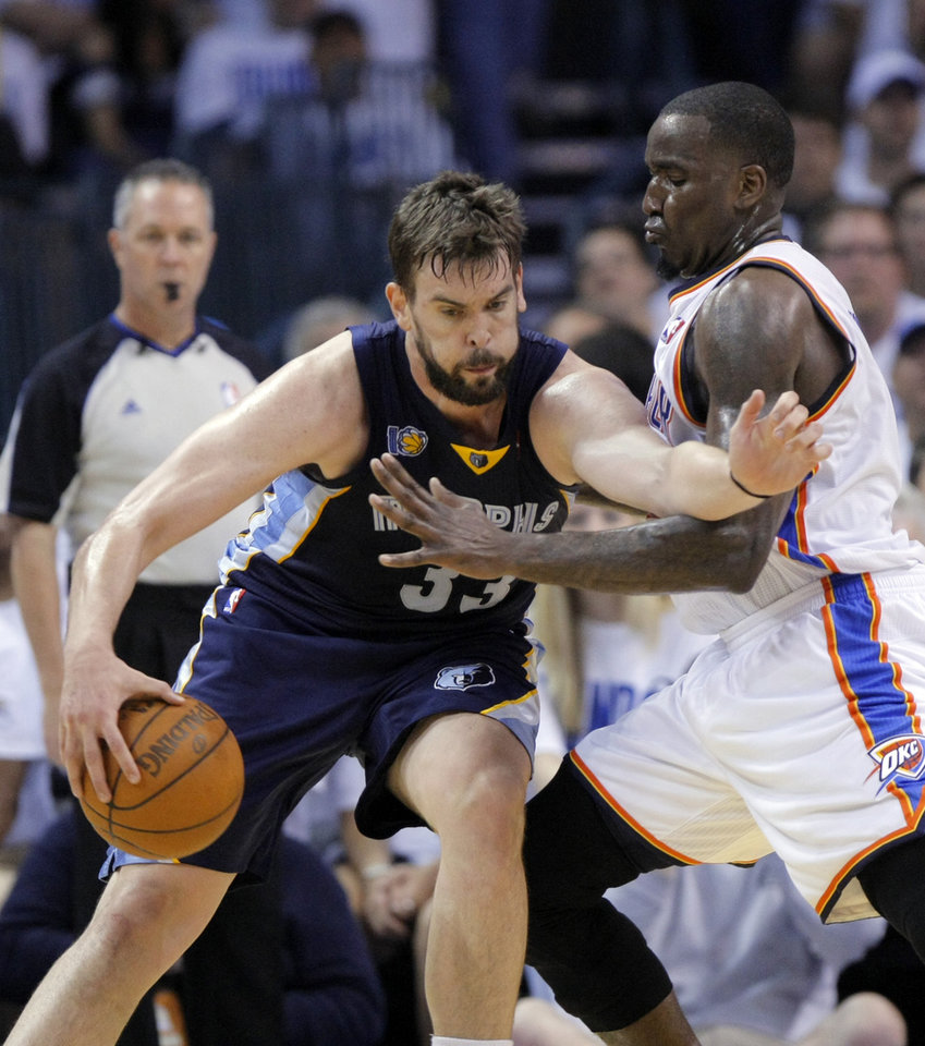 Oklahoma City\'s Kendrick Perkins (5) defends Marc Gasol (33) of Memphis during game five of the Western Conference semifinals between the Memphis Grizzlies and the Oklahoma City Thunder in the NBA basketball playoffs at Oklahoma City Arena in Oklahoma City, Wednesday, May 11, 2011. Photo by Sarah Phipps, The Oklahoman