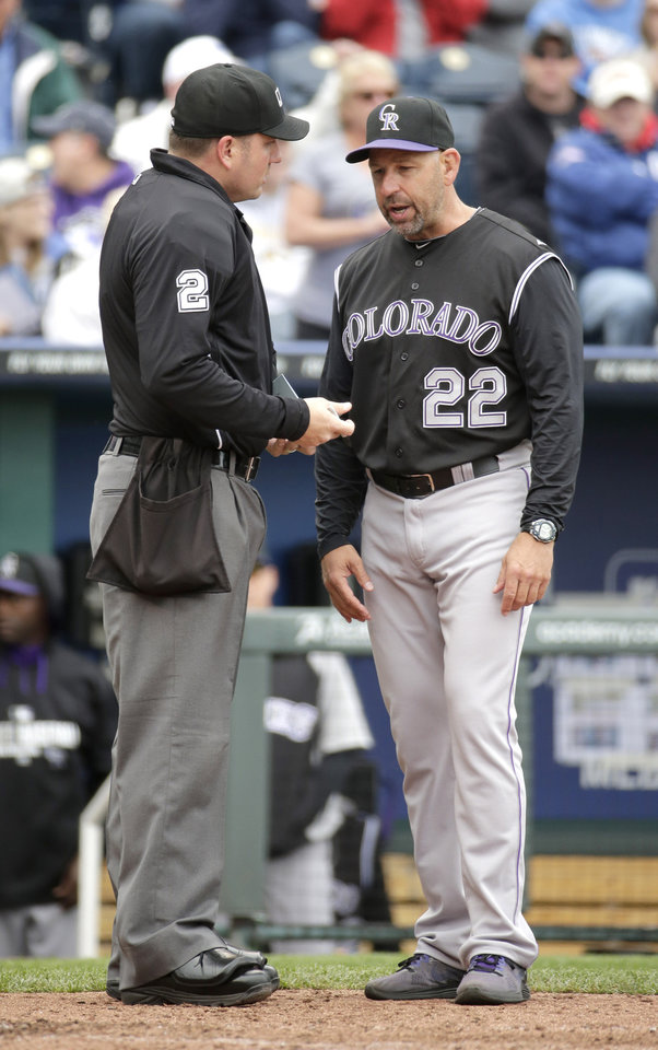 Photo - Colorado Rockies manager Walt Weiss questions a call with home plate umpire Dan Bellino during the fourth inning of a baseball game against the Kansas City Royals Wednesday, May 14, 2014 in Kansas City, Mo. (AP Photo/Charlie Riedel)