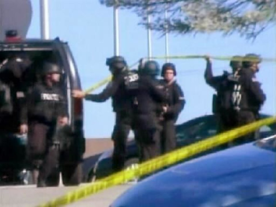 Photo - In this image made from Associated Press Television video, police respond at the scene at the U.S. Army base in  Fort  Hood Texas where a soldier opened fire, unleashing a stream of gunfire that left at least 12 people dead and at least 31 wounded. Authorities killed the gunman, and apprehended two other soldiers suspected in the attack. (AP Photo/APTN)