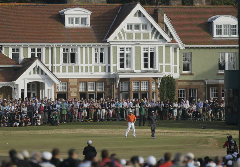 Lee Westwood of England, left, and Tiger Woods of the United States prepare to putt on the 18th green during the third round of the British Open Golf Championship at Muirfield, Scotland, Saturday July 20, 2013. (AP Photo/Jon Super)