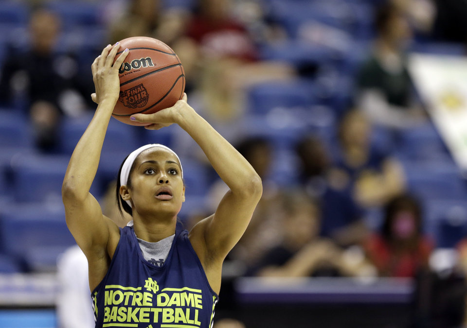 Photo - Notre Dame guard Skylar Diggins shoots during practice at the Women's Final Four of the NCAA college basketball tournament, Saturday, April 6, 2013, in New Orleans. Notre Dame plays Connecticut in a national semifinal on Sunday. (AP Photo/Gerald Herbert)