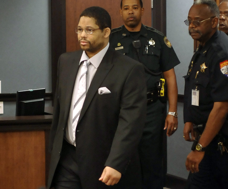 Photo - FILE - In this April 22, 2013 file photo, Bartholomew Granger, left, enters court for the start of his trial in Galveston, Texas. The Houston man convicted of fatally shooting of a 79-year-old woman outside a Southeast Texas courthouse last year has been sentenced to death. (AP Photo/The Beaumont Enterprise, Dave Ryan)