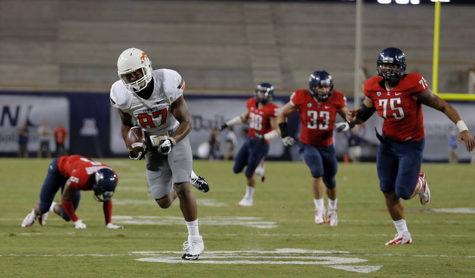 Photo - Oklahoma State's Tracy Moore (87) scores a touchdown during the college football game between the University  of Arizona and Oklahoma State University at Arizona Stadium in Tucson, Ariz.,  Sunday, Sept. 9, 2012. Photo by Sarah Phipps, The Oklahoman