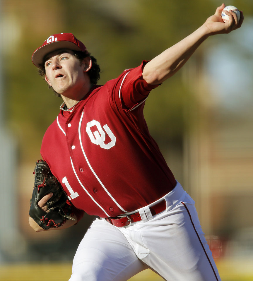 Jacob Evans (11) pitches for Oklahoma during OU's season-opening college baseball game against Seton Hall at L. Dale Mitchell Park in Norman,  Okla., Friday, Feb. 14, 2014. Photo by Nate Billings, The Oklahoman