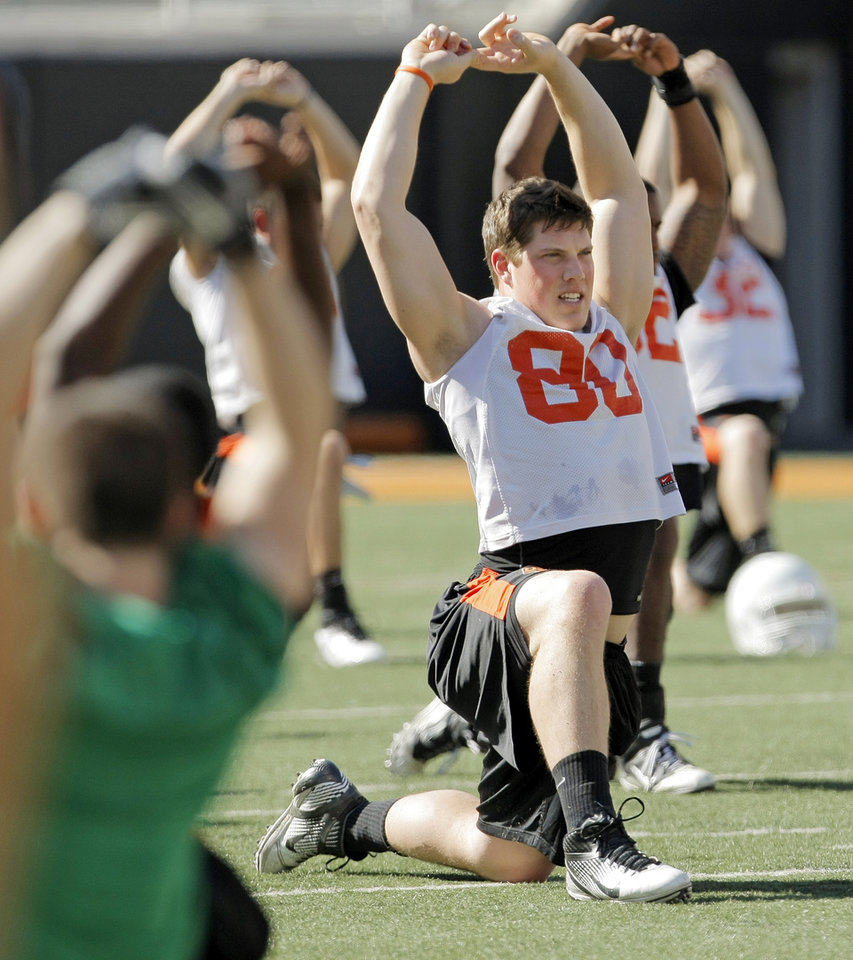 Photo - The OSU Cowboys, including Cooper Bassett (80) stretch during spring football practice at Boone Pickens Stadium on the campus of Oklahoma State University in Stillwater, Okla., Monday, March 12, 2012. Photo by Nate Billings, The Oklahoman