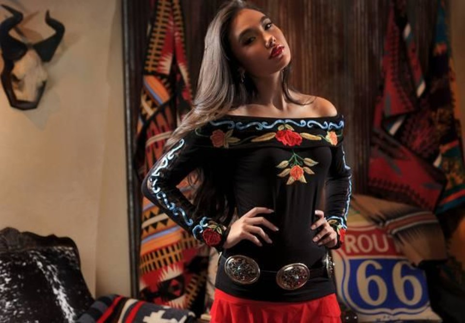 Photo -  Vintage Collection embroidered off-the-shoulder top, Vintage Collection mermaid skirt and Barbosa concho belt from Filigree. Model is Adrianna. Photo by Chris Landsberger, The Oklahoman