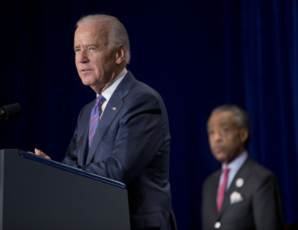 Photo - Vice President Joe Biden delivers the keynote address at the National Action Network's (NAN) Annual King Day breakfast convened by the Rev. Al Sharpton, right,  in Washington, Monday, Jan. 20, 2014. (AP Photo/Pablo Martinez Monsivais)