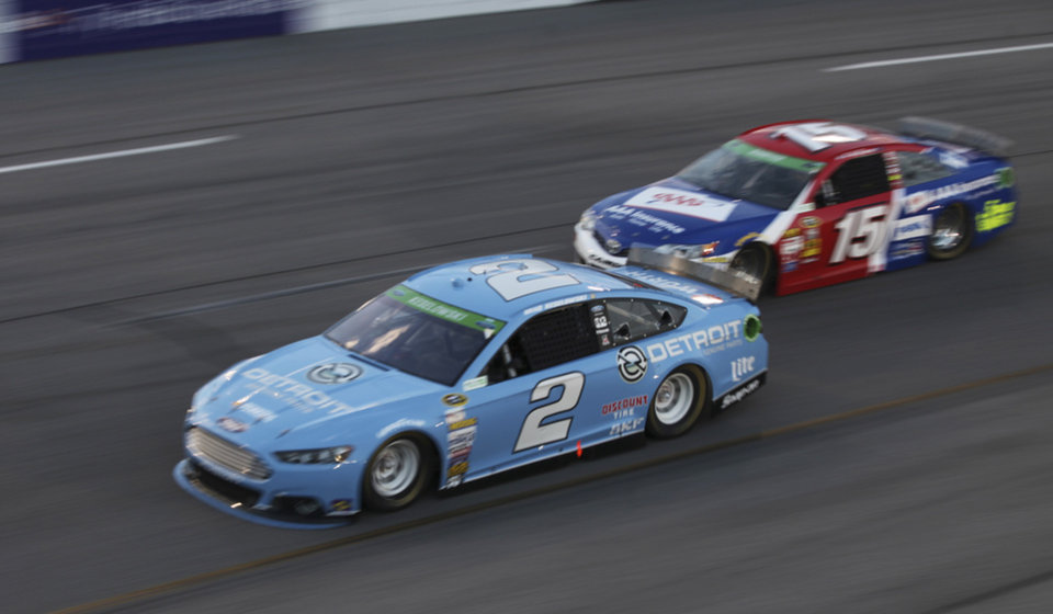 Photo - Brad Keselowski (2) and Clint Bowyer (15) drive through Turn 4 during the NASCAR Sprint Cup auto race at Richmond International Raceway in Richmond, Va., Saturday, April 26, 2014. (AP Photo/Zach Gibson)