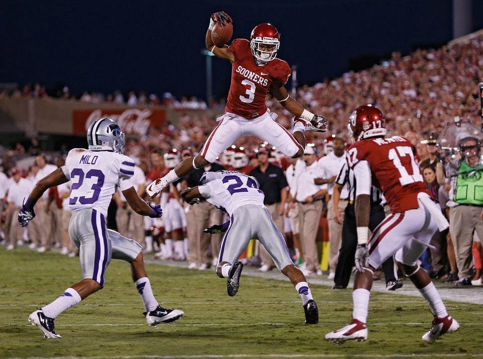 Photo -  Oklahoma's Sterling Shepard (3) leaps over Kansas State's Nigel Malone (24) during the college football game between the University of Oklahoma Sooners (OU) and the Kansas State University Wildcats (KSU) at the Gaylord Family-Oklahoma Memorial Stadium on Saturday, Sept. 22, 2012, in Norman, Okla. Photo by Chris Landsberger, The Oklahoman