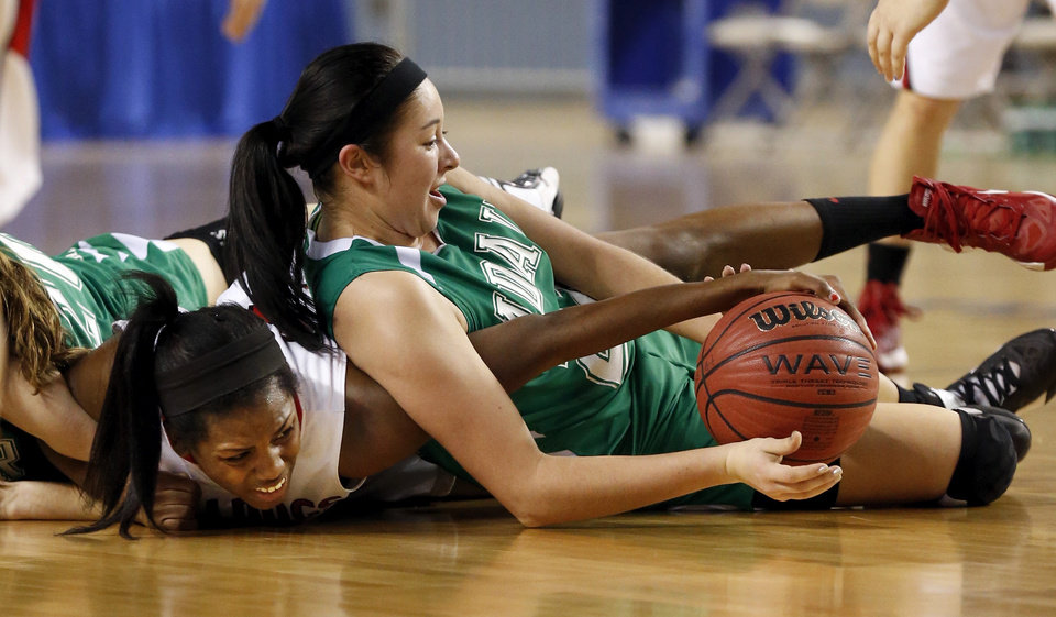 Adair's Kylie Looney, right, fights Ebony Harrison for a ball during the 3A girls semifinal game between the Adair High School Lady Warriors and the Sulphur Lady Bulldogs at the State Fair Arena on Friday, March 8, 2013 in Oklahoma City, Okla.  Photo by Steve Sisney, The Oklahoman