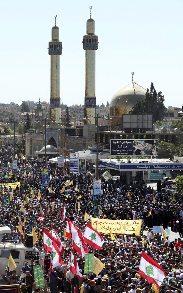 Tens of thousands of people take part in a protest in Lebanon's eastern city of Baalbek, Lebanon, Friday, Sept. 21, 2012, in the latest in a series of protest rallies organized by the Shiite militant group Hezbollah. Anger over insults to Islam's Prophet Muhammad isn't enough to bring Lebanon's divided Sunni and Shiite Muslims together. The two sects, which have been locked in sometimes violent political competition, hold separate protests. A hardline Sunni cleric accuses Shiite Hezbollah of using the protests to distract from the fighting in neighboring Syria. AP photo