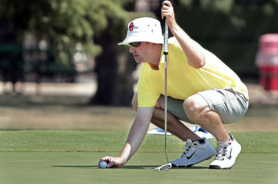 Photo - Ryan Munson lines up a putt at the 37th annual Westwood Invitational Golf Tournament.  PHOTOs BY STEVE SISNEY, THE OKLAHOMAN