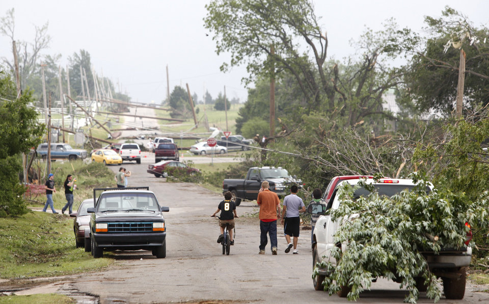 Photo - Downed power lines block East Highland street in Tecumseh, Oklahoma May 11 , 2010. Photo by Steve Gooch, The Oklahoman