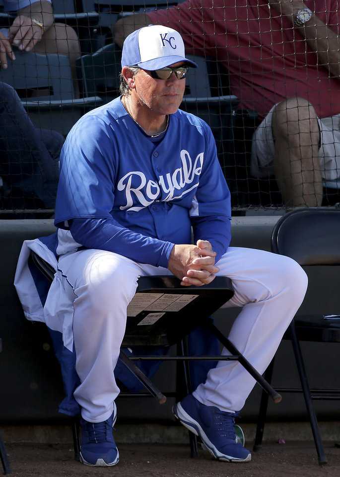 Kansas City Royals manager Ned Yost watches during the fifth inning of an exhibition spring training baseball game against the Cincinnati Reds Friday, March 1, 2013, in Surprise, Ariz. (AP Photo/Charlie Riedel)