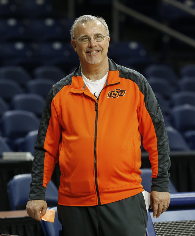 Photo - Oklahoma State head coach Jim Littell smiles during an NCAA women's college basketball tournament practice at the Purcell Pavilion in South Bend, Ind., Friday, March 28, 2014. Oklahoma State plays Notre Dame on Saturday. (AP Photo/Paul Sancya)