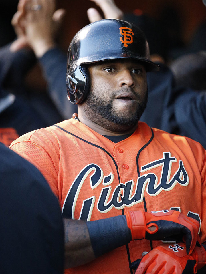 Photo - San Francisco Giants' Pablo Sandoval is congratulated by teammates in the dugout after hitting a three-run home run off Minnesota Twins starting pitcher Kyle Gibson in the first inning of a baseball game Friday, May 23, 2014, in San Francisco. (AP Photo/Tony Avelar)